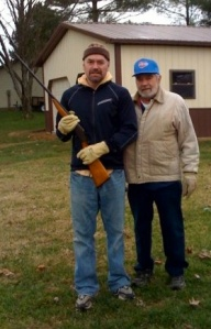 With a shotgun my Grandpa gave my Dad when he was nine; I inherited it when I reached that age.  This picture was taken right after Dad started chemo; we went target shooting in the woods for the last time together this day.